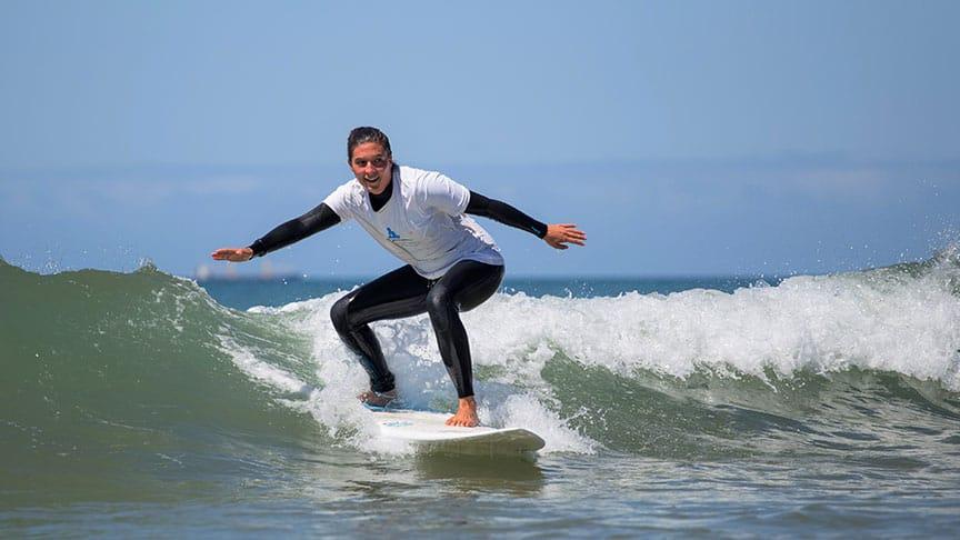 surf lesson advanced girl smiling