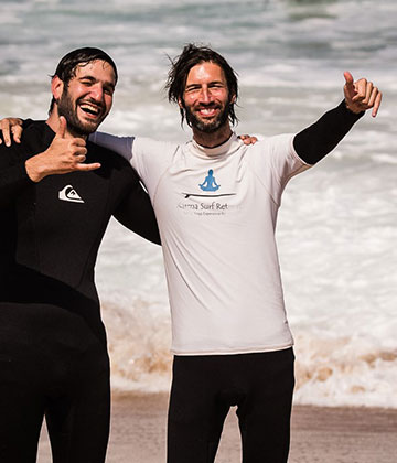 surf instructor and student shaka on the beach