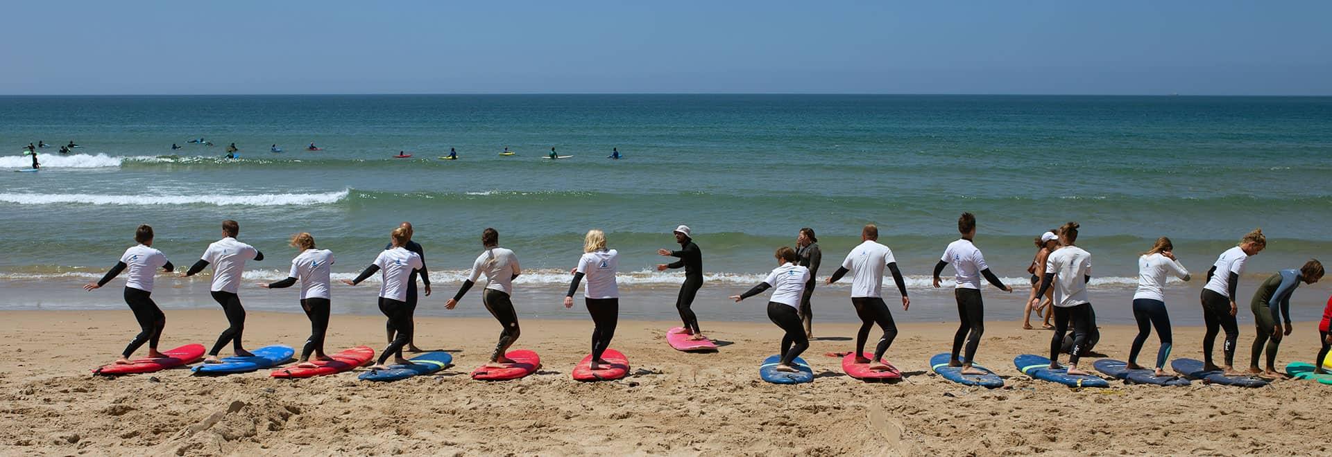 group surfing lesson beginner lisbon algarve