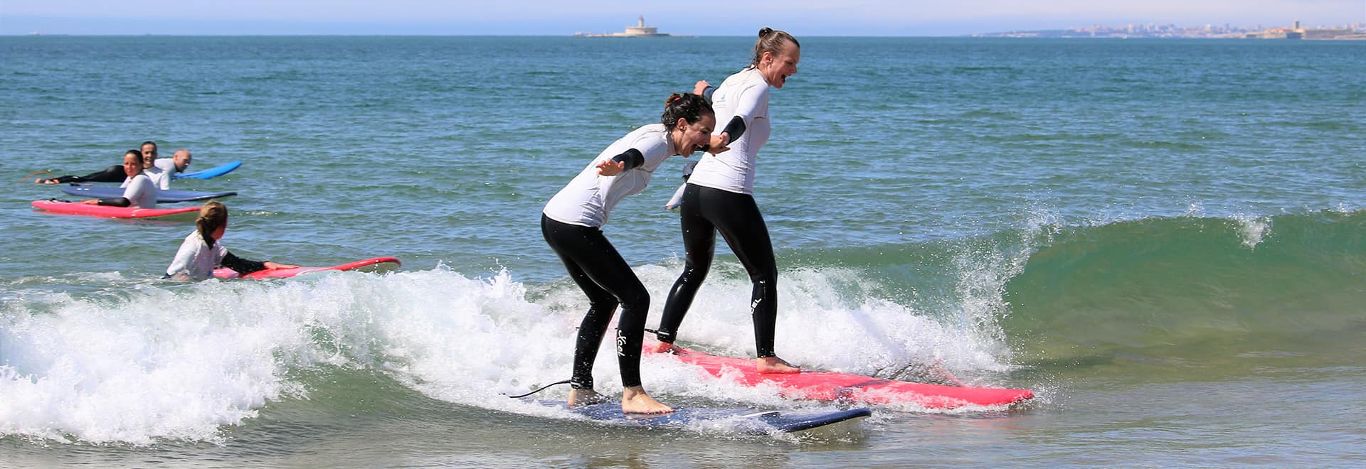 surf students surfing during lesson