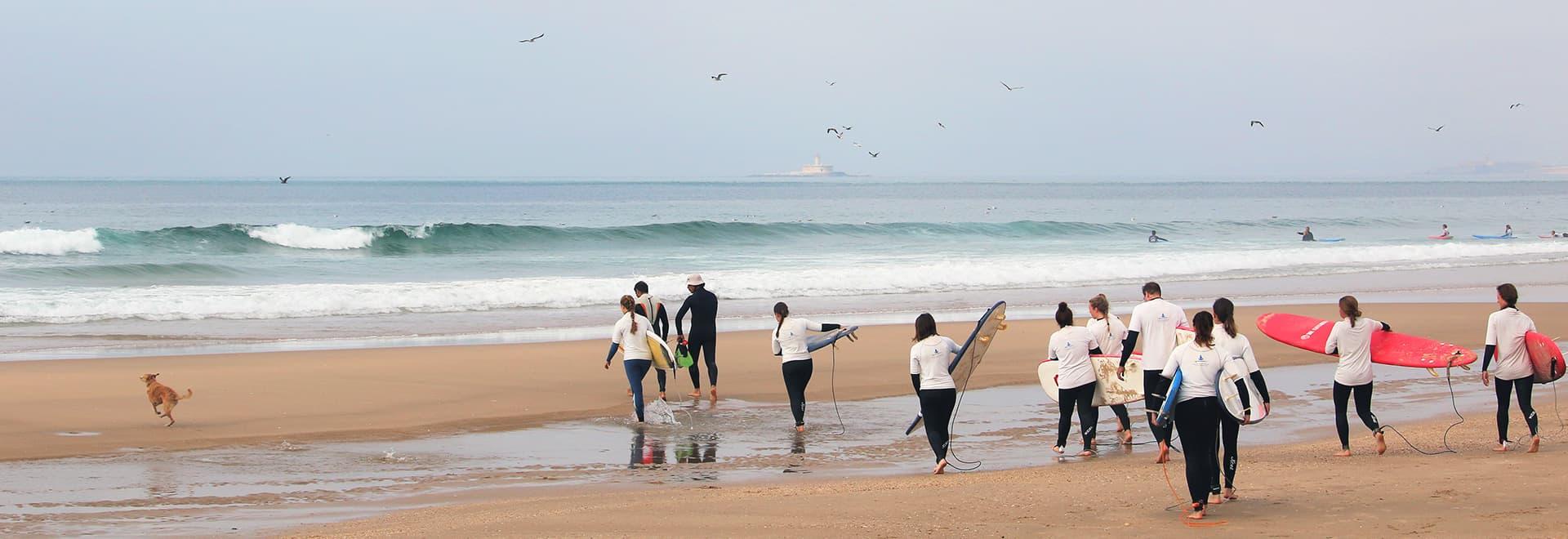 group surf lesson caparica lisbon